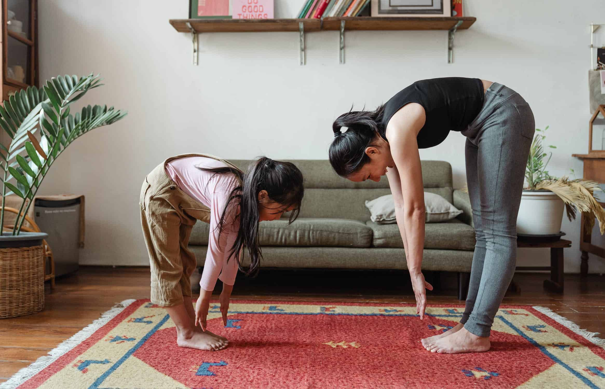 Mum and daughter doing yoga