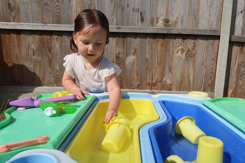 Erin playing with the water table