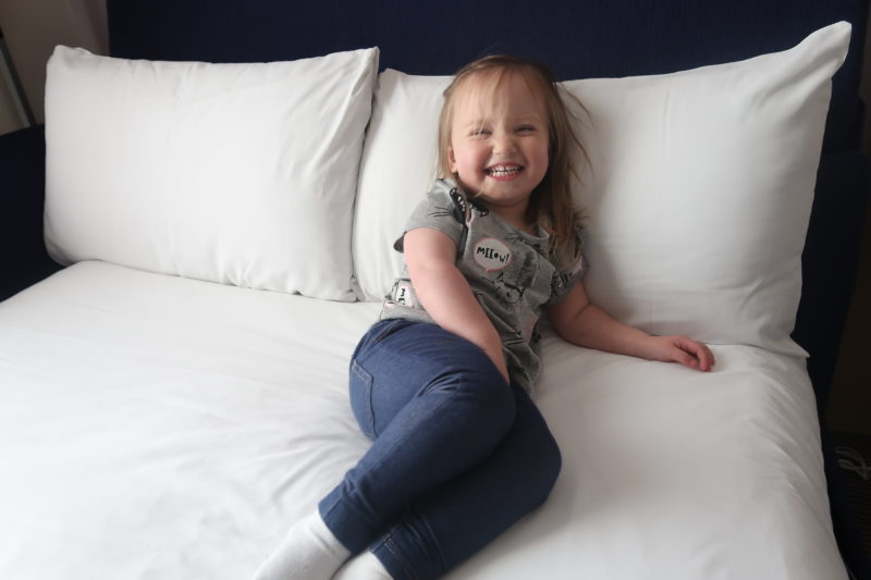 Erin on a hotel bed