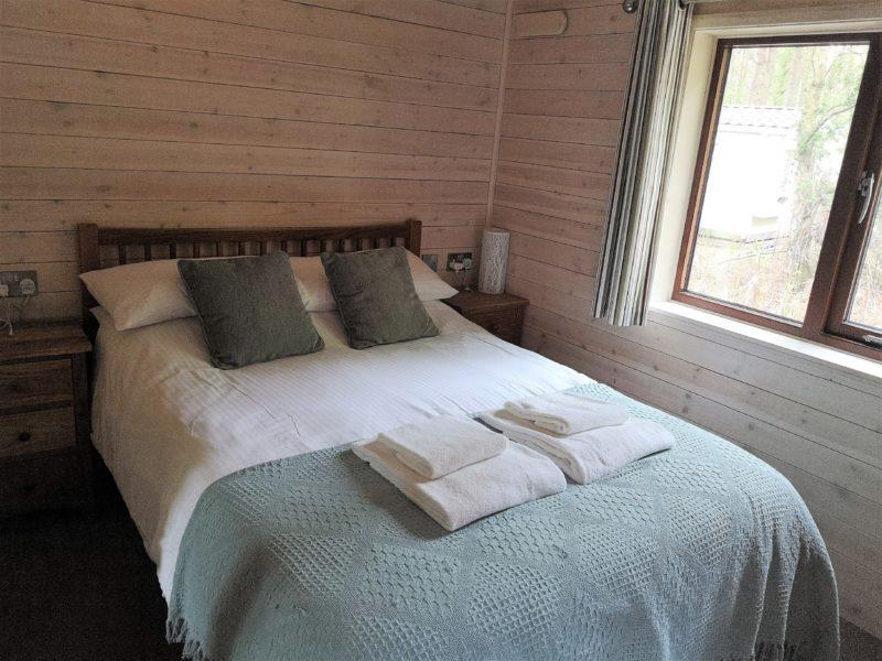 Kelling Heath 2 bedroom woodland lodge master bedroom