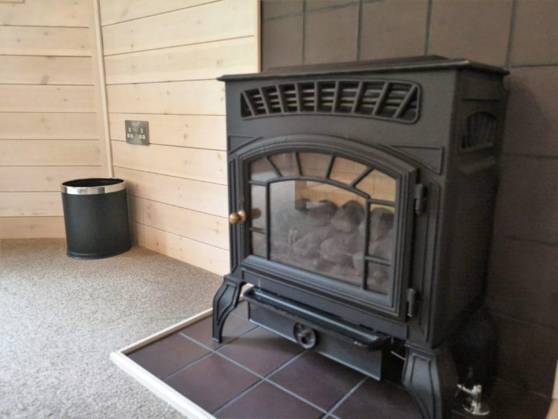 Kelling Heath 2 bedroom woodland lodge fireplace
