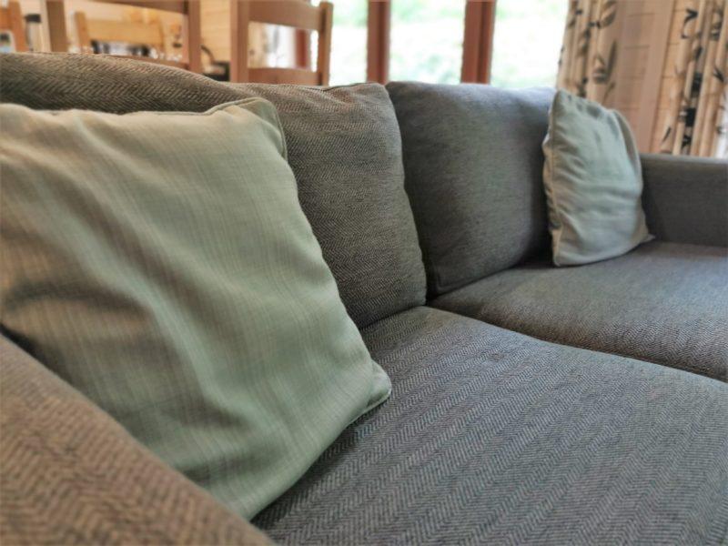 Kelling Heath 2 bedroom woodland lodge sofa