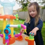 Erin playing with the Little Tikes Fountain Factory Water Table