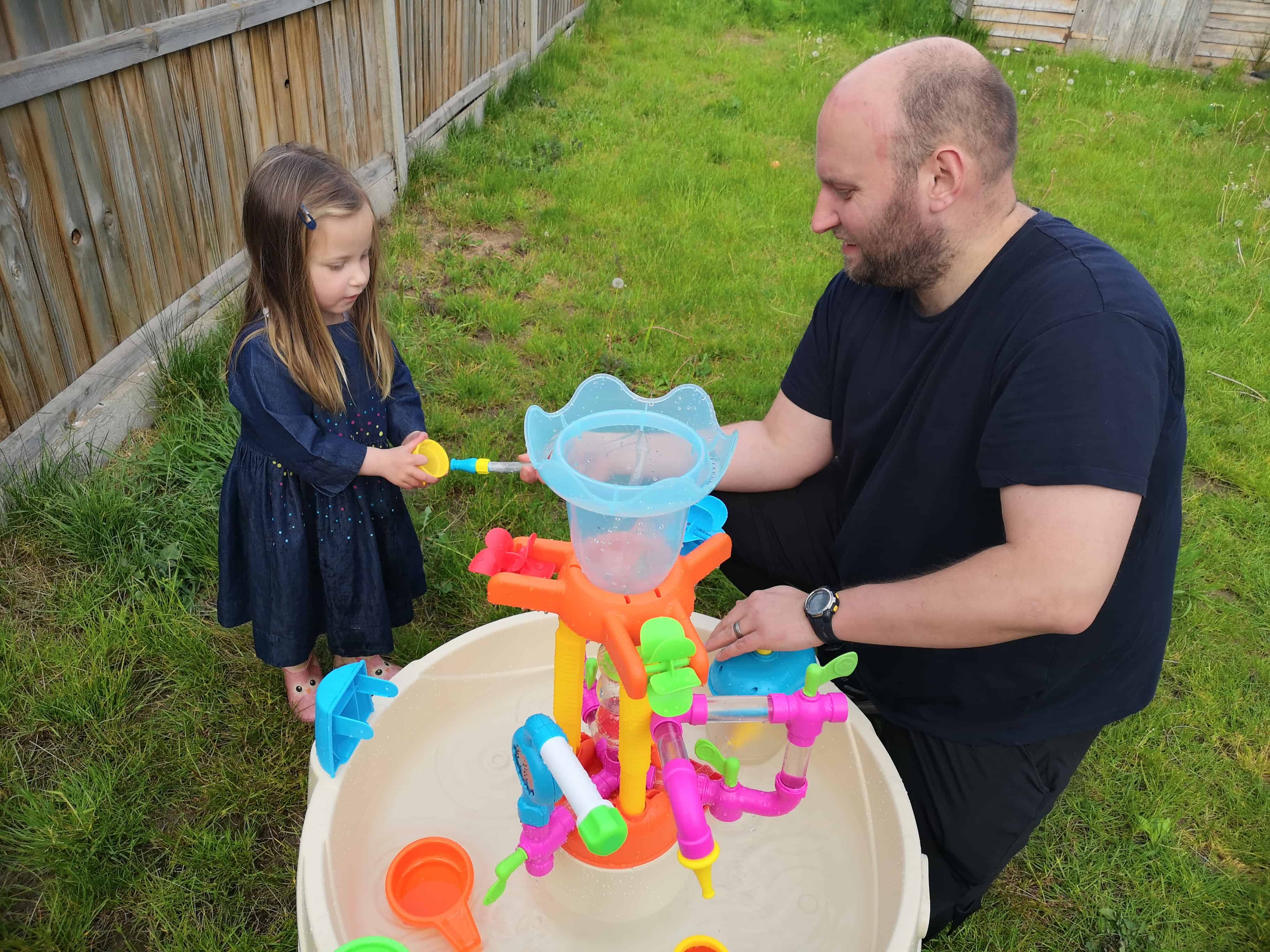 Erin and John playing with the Little Tikes Fountain Factory Water Table