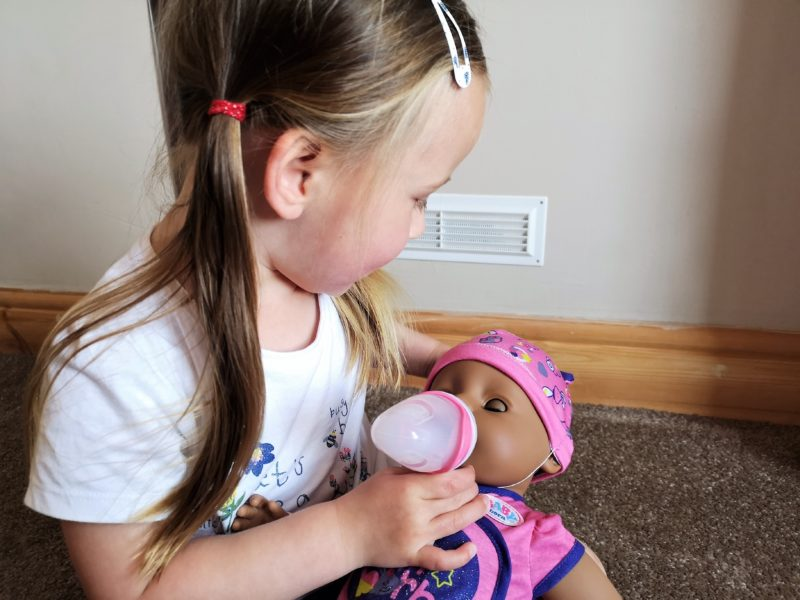 Erin giving the BABY born Soft Touch Doll a bottle