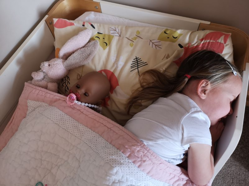 Erin asleep with the BABY born Soft Touch Doll