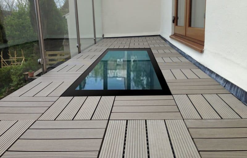 Glass on balcony floor