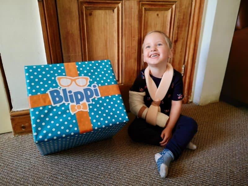 Erin with the Blippi box