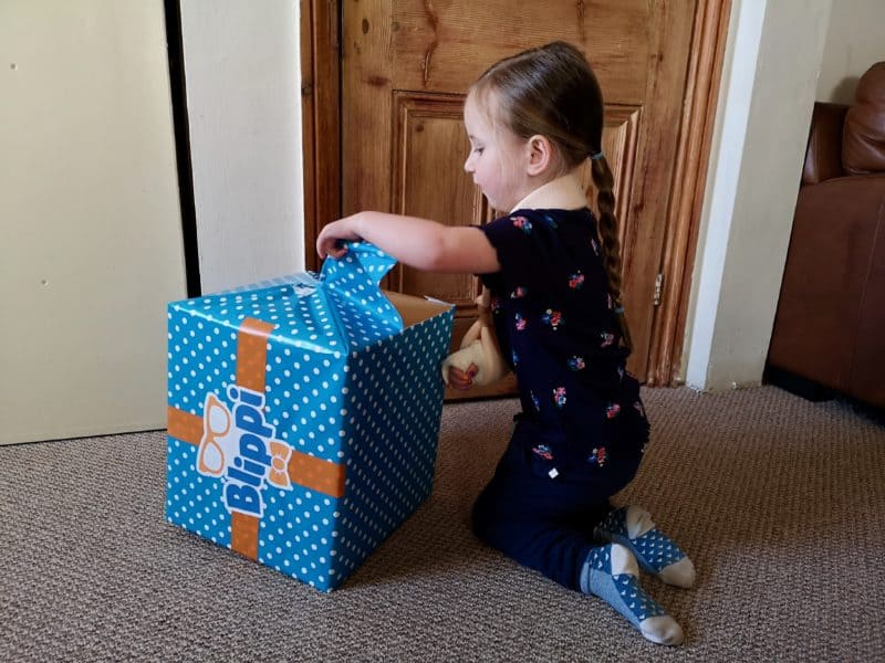 Erin opening the Blippi box