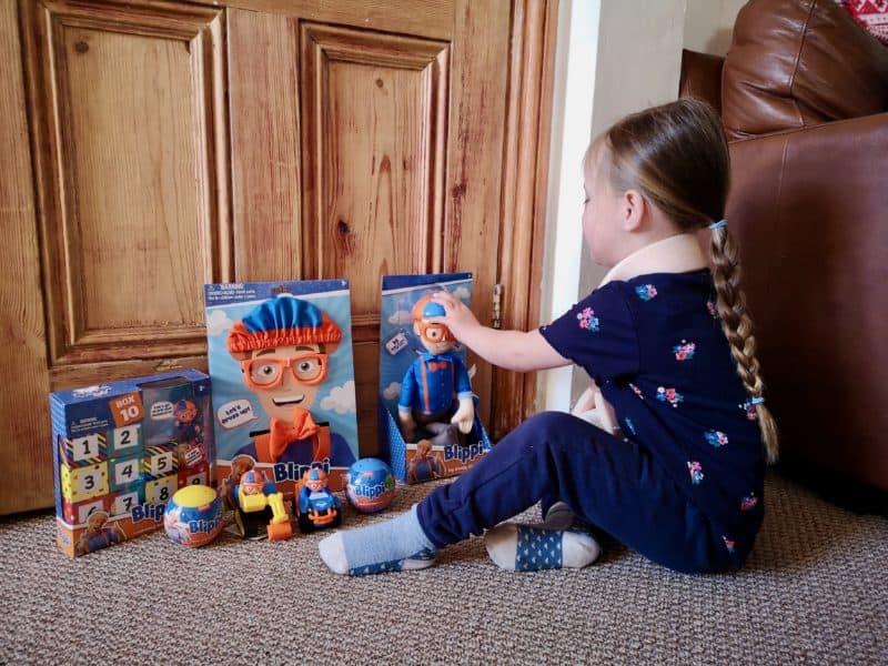Erin with the Blippi toys