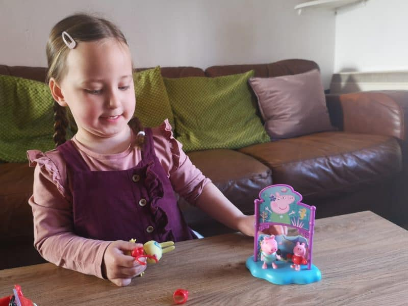 Erin playing with Peppa Pig toys