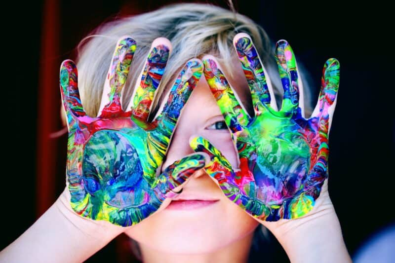 Child with colourful hands