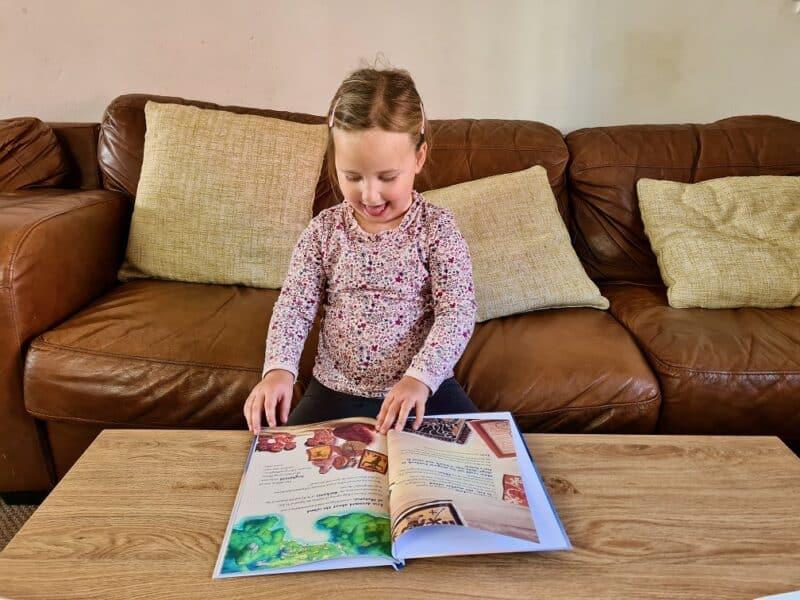 Erin reading In The Book Moana