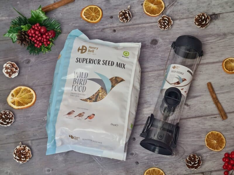 Essentials Plus Seed Feeder, along with a bag of bird seed, from Henry Bell