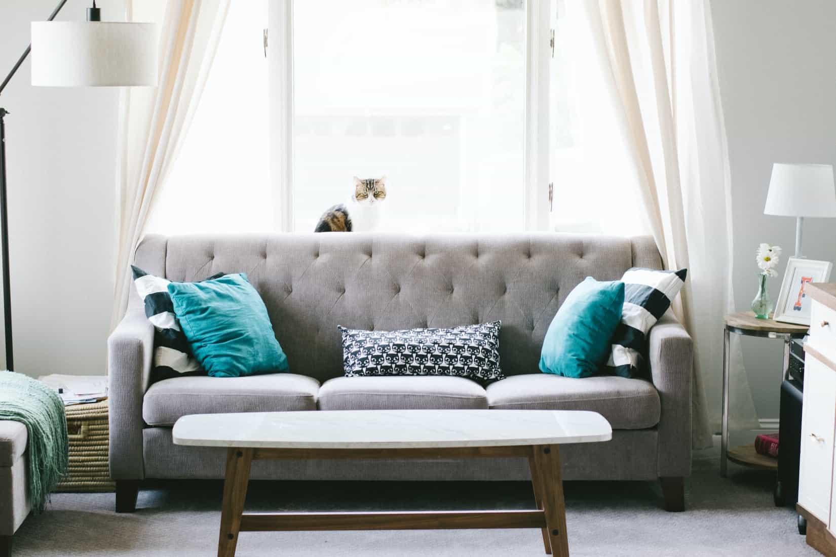 Grey sofa with cushions