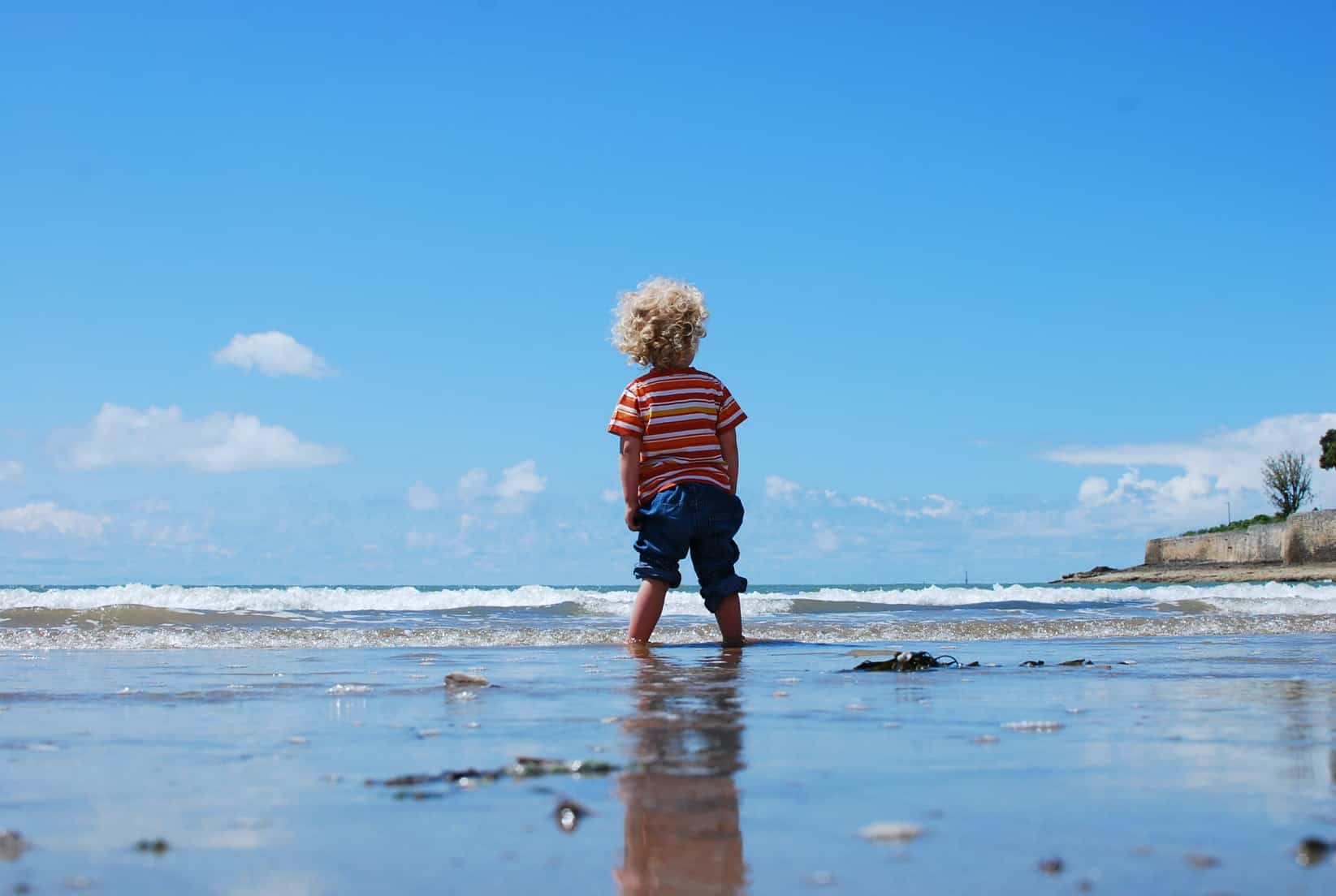 Child stood in the sea