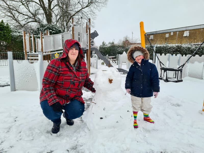 Me and Erin with a snowman