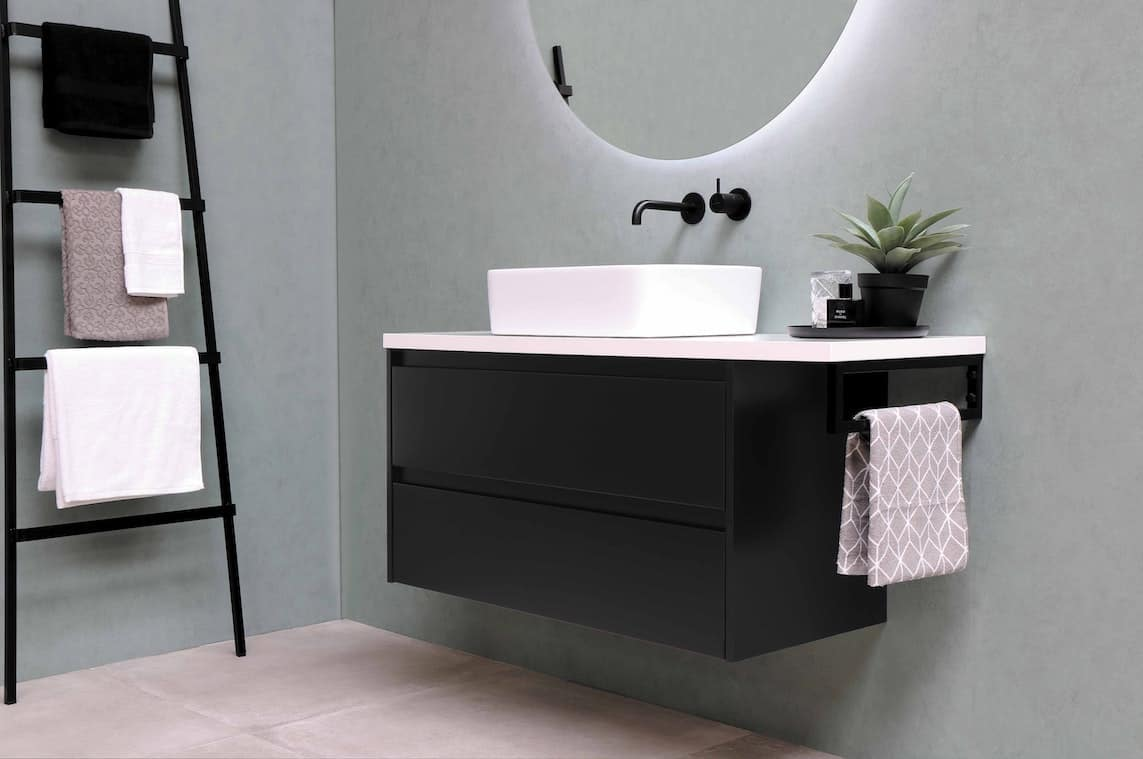 Bathroom sink with hanging towels