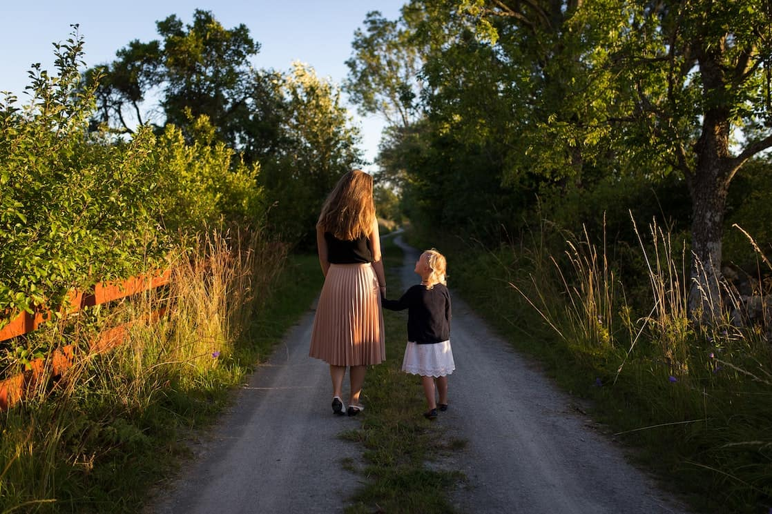Mother and daughter on a road