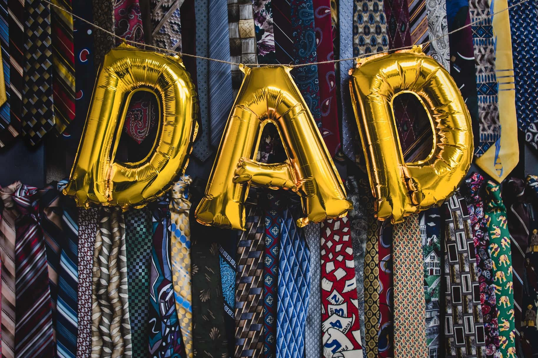 Dad balloons in front of ties