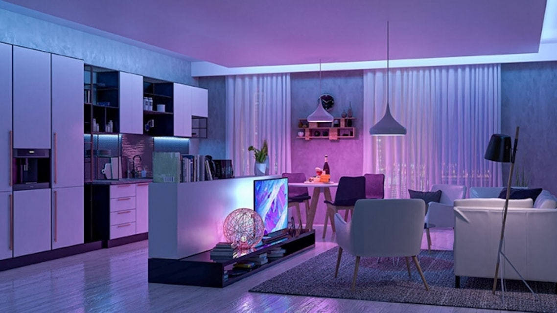 Living room and kitchen with TV on