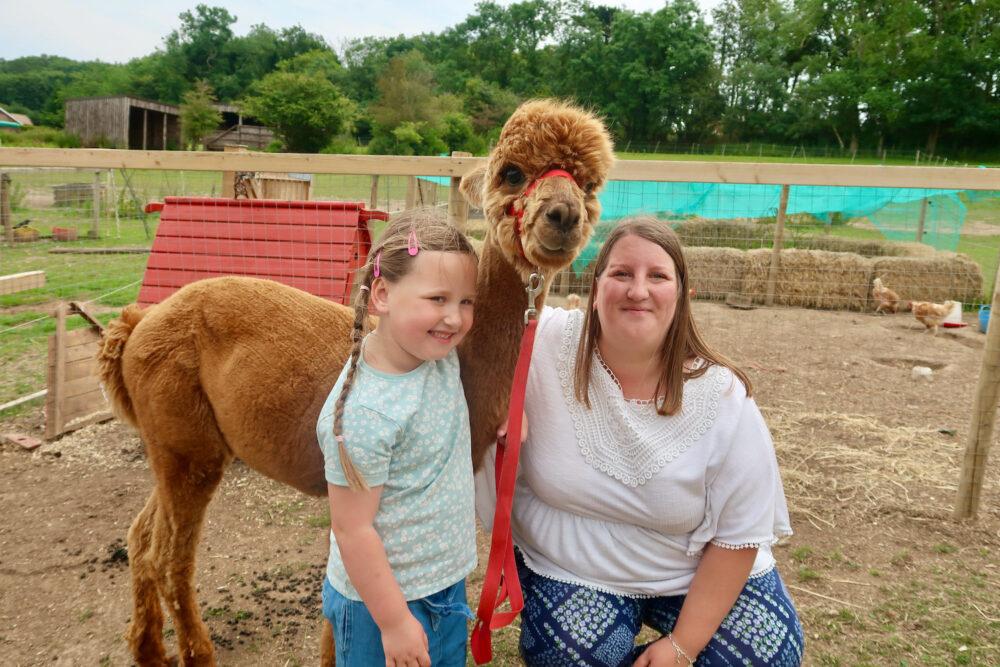 Bumblebarn me and Erin with an alpaca