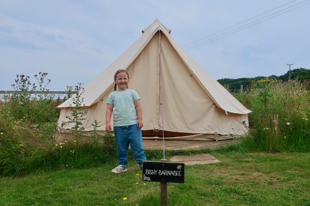 Erin in front of the bell tent