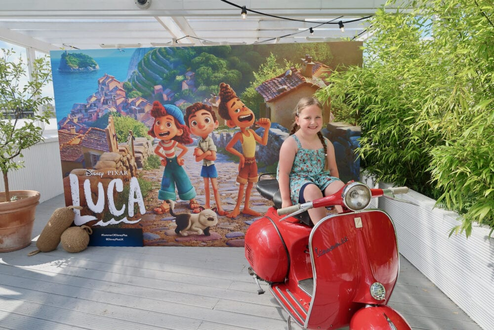 Erin on a vespa at the summer of Disney Plus event