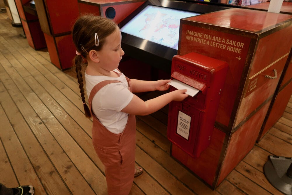 Erin posting a letter on the Cutty Sark