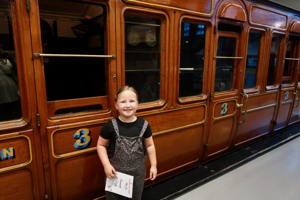 Erin with steam train at London Transport Museum