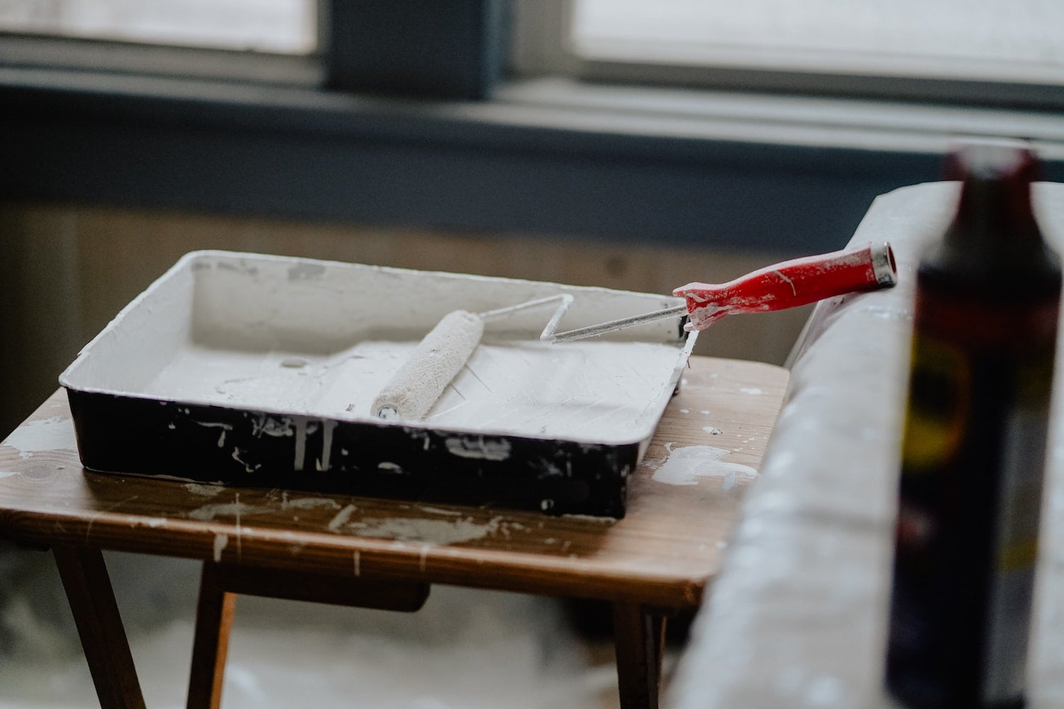 Paint and roller on a table