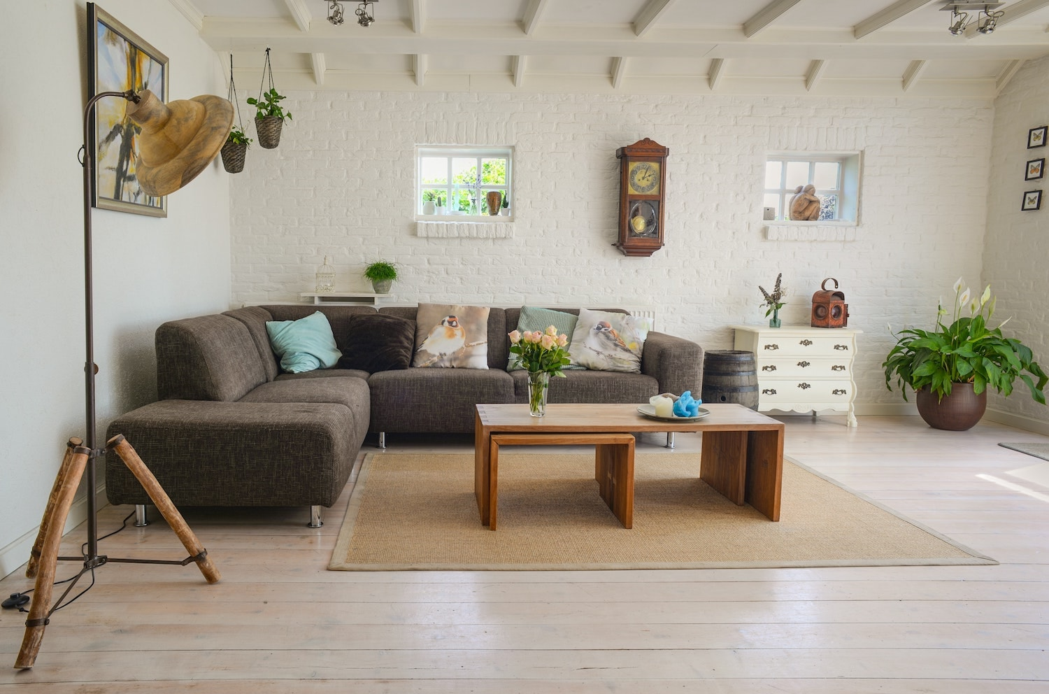 Brown sofa in a living room with wooden table