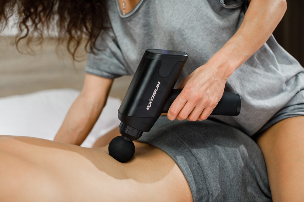 ExoGun DreamPro being used by a woman on a back