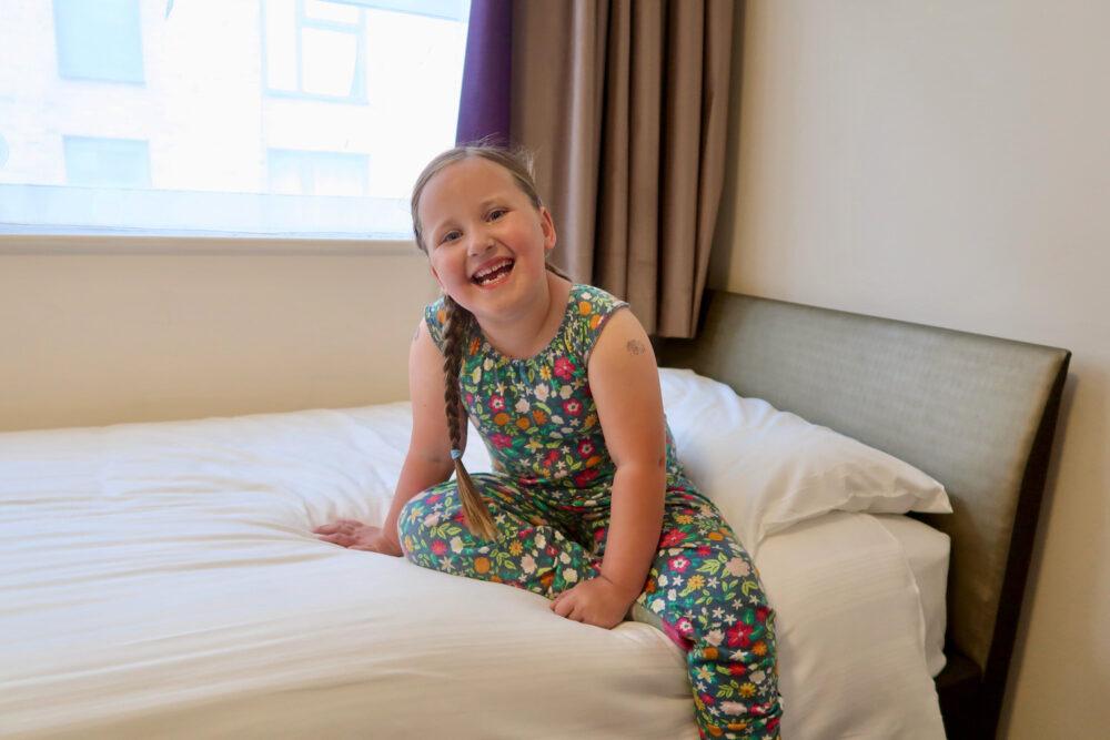 Premier Inn Greenwich Erin sat on a bed