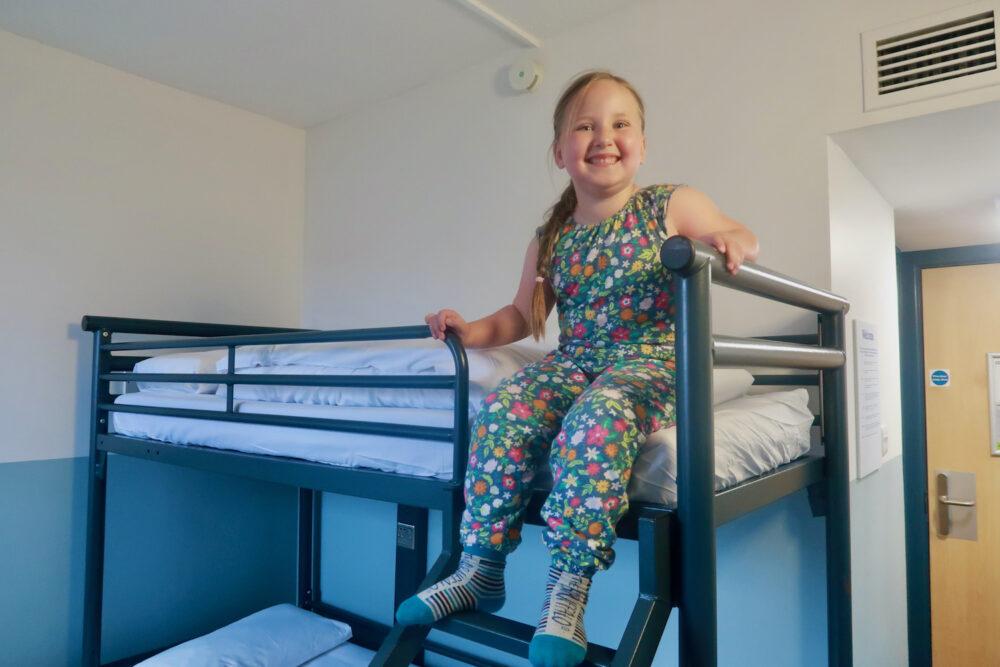 YHA St Pancras Erin sat on the bed