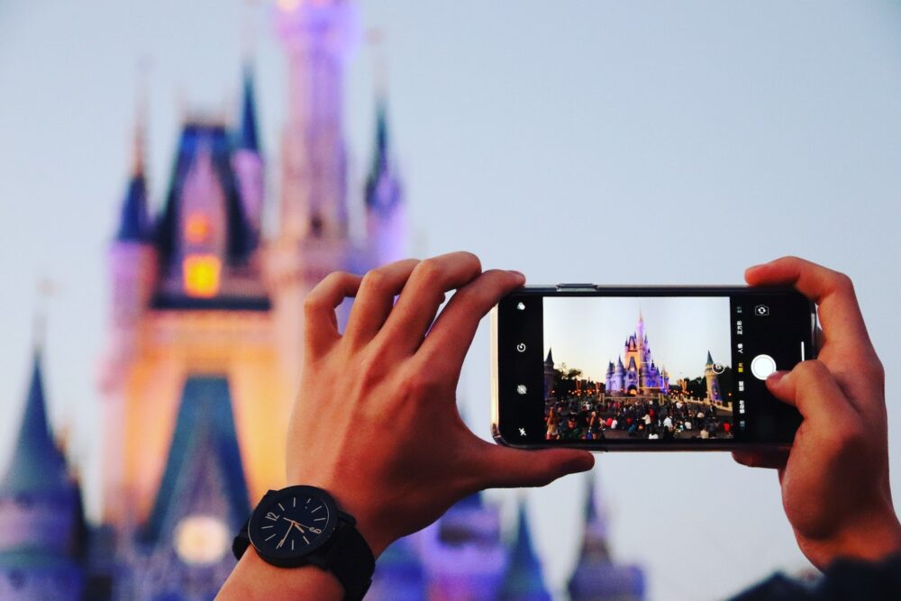 Person taking a picture of the Disney castle