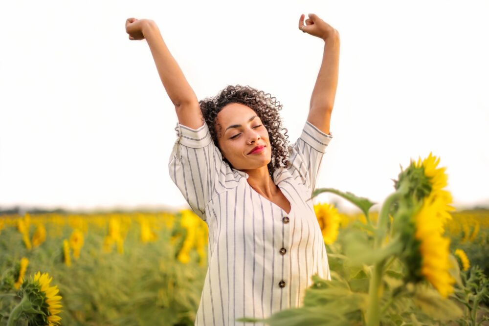 woman putting her hands up in the air