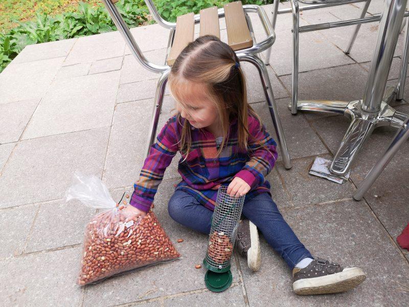 Erin filling the birdfeeder