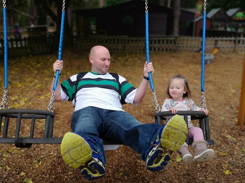 John and Erin on the swings