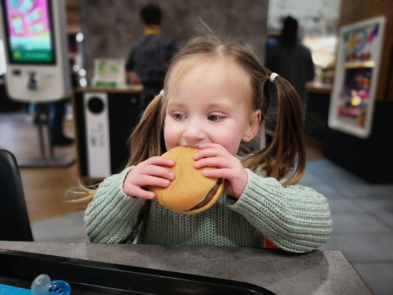 Erin eating a hamburger