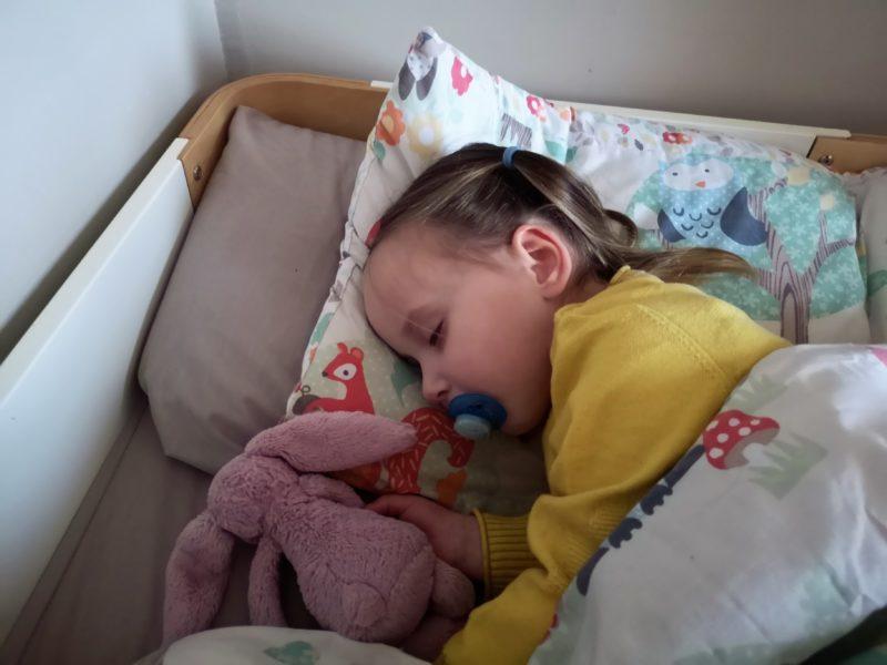 Erin asleep in bed